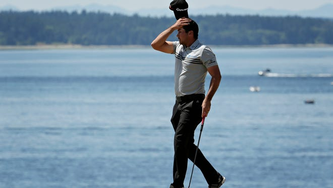 Jason Day, of Australia, reacts after missing his par putt on the second hole during the third round of the U.S. Open golf tournament at Chambers Bay on Saturday, June 20, 2015 in University Place, Wash.