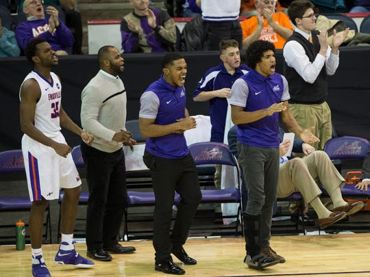 University of Evansville's Dru Smith, right, cheers on his team from the bench at the Ford Center on Wednesday, Jan. 31, 2018. The Purple Aces defeated the Panthers 57-49. Smith sat out of the game with a foot injury.