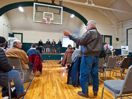 Farmer Arthur Boulerice of Swanton rises to ask a question of (from left, rear) Attorney General Bill Sorrell, Department of Environmental Conservation Commissioner David Mears, Secretary of Agriculture Chuck Ross and Tim Smith of the Franklin County Industrial Development Corporation during a meeting in St. Albans on Monday, January 26, 2015 on the state's new efforts to improve water quality in Lake Champlain.