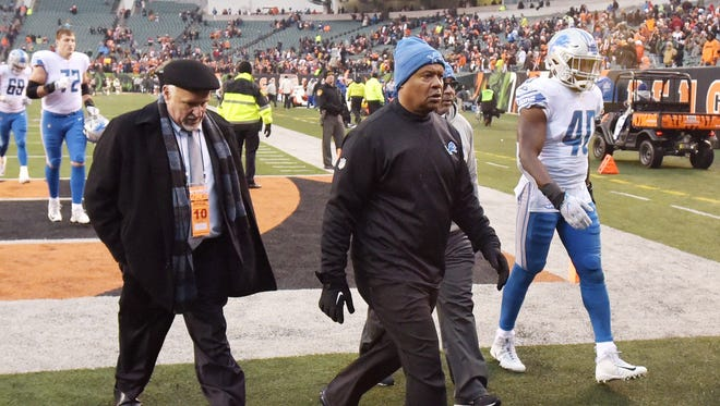 Lions head coach Jim Caldwell leaves the field after the 26-17 loss to the Cincinnati Bengals.