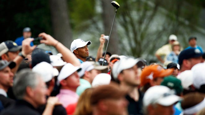 Tiger Woods tees off on the 1st hole during a practice round for The Masters golf tournament at Augusta National Golf Club.