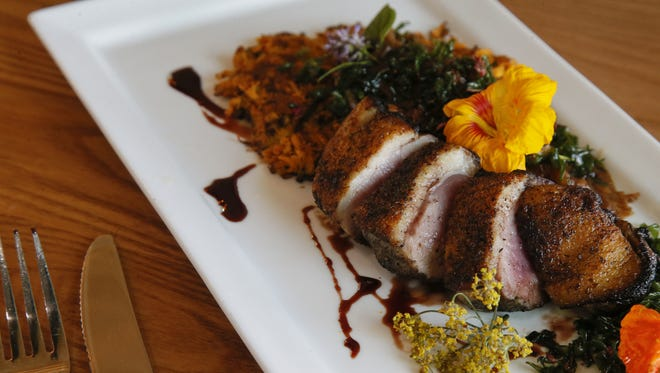 The double duck entree, seared breast served with sweet potato pancake, duck confit and crispy Swiss chard at the Brown Dog Cafe.