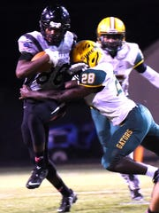 Parkway's Terrace Marshall tries to get past Captain Shreve's defense Friday evening at Preston Crownover Stadium.