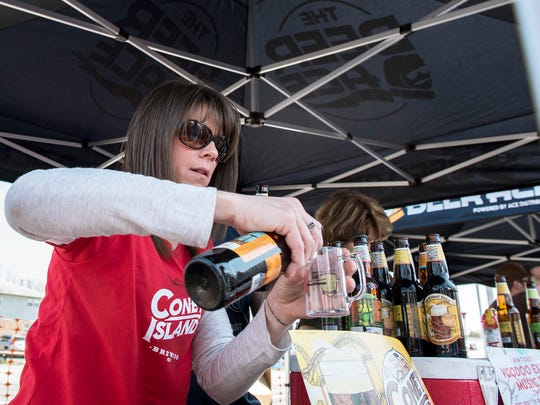 Nicole Stahl pours a Coney Island hard ginger ale for