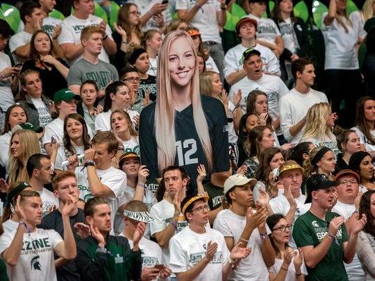 A Michigan State fan holds up a cut out of women's volleyball player Rachel Minarick during the match against Michigan on Wednesday, Oct. 18, 2017, at the Jenison Field House in East Lansing.