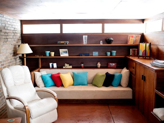 A built in couch and shelves seen in the main living area inside the Goetsch-Winckler House on Thursday, Feb. 15, 2018, in Okemos. The home was built in 1940 and was designed by architect Frank Lloyd Wright.