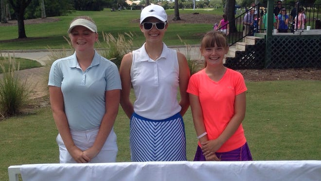 Claire Sattler of Bonita Springs (center) won the Girls 14-15 Division at the Drive, Chip and Putt Championship local qualifier at Stoneybrook Golf Club in Estero on Thursday. Megan Brooks of Fort Myers (left) and Sarah Matkowski of Cape Coral also advanced to the subregional on Aug. 13.
