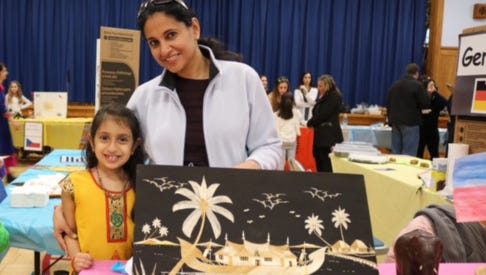 Rachel Gabriel and her mother Sweety Gabriel share the culture of India at the event.