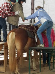 Sonrisas Trails offers therapeutic horseback riding to children and adults with special needs and also to military veterans