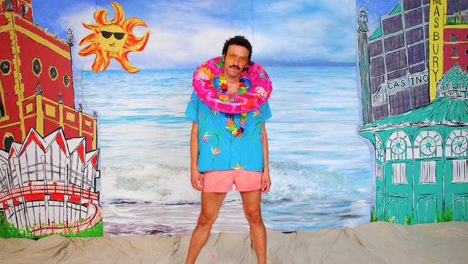 Asbury Park Press art columnist Billy Anania poses for a photoshoot at the boardwalk pop-up studio.