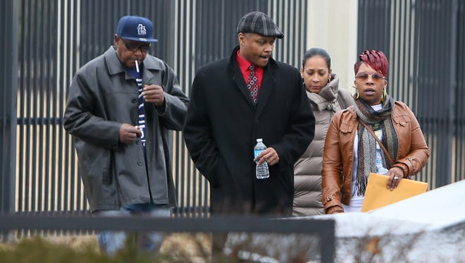 Michael Brown's mother, Lesley McSpadden, far right, leaves the FBI offices in St. Louis after meeting with federal officials on Wednesday, March 4, 2015. The Justice Department won't prosecute a former Ferguson, Missouri, police officer in the shooting death of Michael Brown, but in a scathing report released Wednesday faulted the city and its law enforcement for racial bias and unconstitutional practices.
