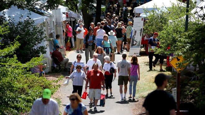 The temperature reached 99 degrees Saturday at the Salem Art Fair & Festival.