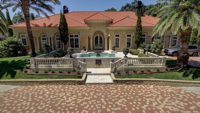 This amazing Greenbriar estate, located at 103 Riverbriar Drive, has 5 bedrooms, 7 1/2 bathrooms and 7,140 sq ft of living. It is listed at $2,700,000.