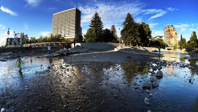 The Truckee River flows towards downtown Reno on June 17, 2015. Local forecasters expect sunny skies this weekend.
