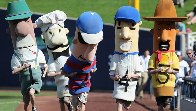 Sausages -- although not these -- are processed meats and found to be carcinogens, according to the World Health Organization.   The Sausage Race mascots compete during the spring training game between the San Diego Padres and Milwaukee Brewers at Maryvale Baseball Park on March 7, 2014 in Phoenix, Arizona.  (Photo by Christian Petersen/Getty Images) ORG XMIT: 477434235 ORIG FILE ID: 477164581