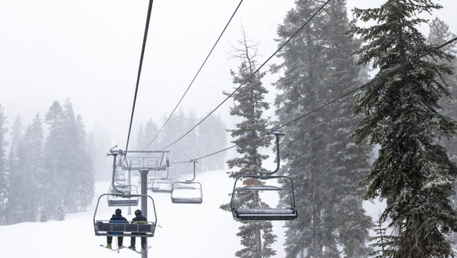 This December 2015 photo provided by the Northstar California Resort shows skiers riding a lift at the facility in Truckee, Calif.