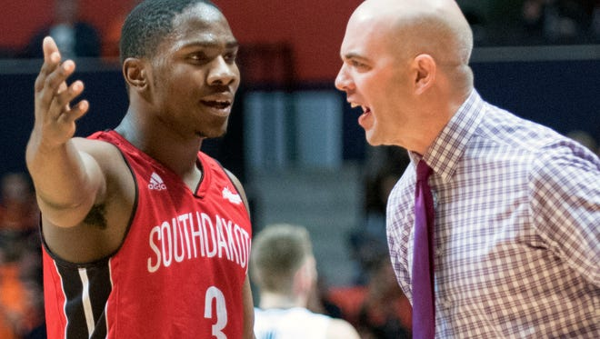 South Dakota's head coach Craig Smith has a fews words with guard Shy McClelland (3) after McClelland received a technical foul during an NCAA  college basketball game against Illinois, Saturday, Dec. 19, 2015 in Champaign, Ill. (AP Photo/Robin Scholz)