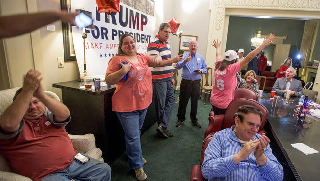 Donald Trump fans celebrate as Trump wins another state while watching election night returns at the Montgomery County Republican Headquarters in Montgomery, Ala. on Tuesday evening November 8, 2016.