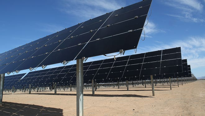 Solar panels tilt upward to track the sun's movement through the sky at NextEra's 250-megawatt McCoy solar project in eastern Riverside County on Nov. 10, 2016.