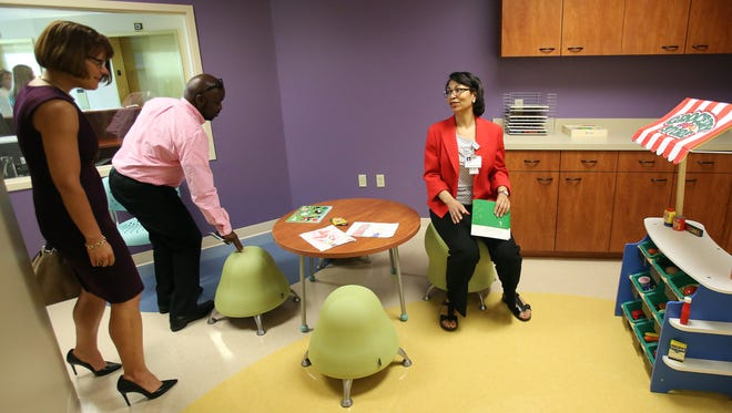 April 16, 2015 - Community liaison Susan Hopson (right) describes the facilities of a Universal Parenting Place (UPP) that was dedicated on Thursday at Baptist Memorial Hospital for Women. A second location was dedicated at Knowledge Quest.  UPPs are judgment-free zones where parents can receive professional counseling, information, and emotional support for family-related issues. (Stan Carroll/The Commercial Appeal)