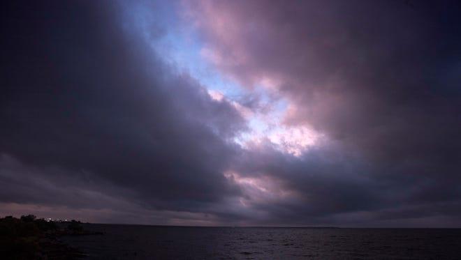 Darkening skies and calm seas greet Pensacola Bay Saturday morning Oct. 7, 2017, as Hurricane Nate threatens the Gulf Coast.