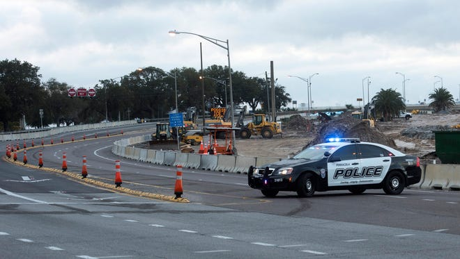 A Pensacola Police Department patrol car blocks the entrance to the Pensacola Bay Bridge on Jan. 17, 2018, because of icy conditions on the road.