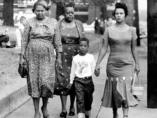 Erroll Groves, second from right, with his mother, Mrs. Iridella Groves, right, and other family members walk to Buena Vista School on the first day of school Sept. 9, 1957.