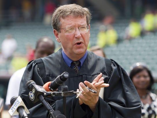 Larry McKinney, presiding over a naturalization ceremony