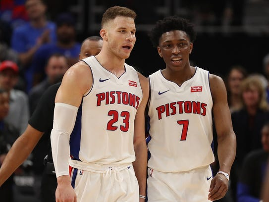 Blake Griffin, left, and Stanley Johnson talk late