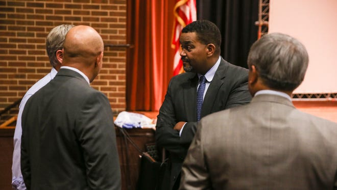 In this Sunday, Aug. 27, 2017 photo, City Manager Maurice Jones speaks to officials in the Martin Luther King Jr. Performing Arts Center before a community meeting organized by the Department of Justice's Community Relations Service in Charlottesville, Va. Charlottesville residents told city leaders at an emotional community meeting they were traumatized by a white nationalist rally and dissatisfied with the way officials handled the event and the violence that unfolded.