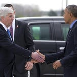 President Barack Obama is greeted by Michigan Gov. Rick Snyder as he arrives on Air Force One at Bishop International Airport in Flint, Mich., Wednesday, May 4, 2016. The president is in Flint, Mich., to discuss the ongoing water crisis. (AP Photo/Carolyn Kaster)