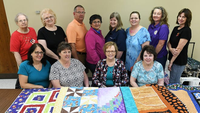 Back row, from left, Macomb County Quilt Guild board members Peggy Lau of Marysville, Gina Kaszynski of Casco, Dan Markey of Burtchville, Patti Mitvowski of St. Clair Shores, Kathy Redmond-Stevens, Jill Stiger of Mount Clemens, Anita Groninger of Macomb Township and Sue Sharkey of Sterling Heights. Front row, from left, Sandi Miski of Mount Clemens, Cindy Todd of Sterling Heights, Colleen Belli of Washington Township, Linda Fenska of Sterling Heights. Photos taken at at the Macomb County Quilt Guild board meeting at the Mount Clemens Library in Mount Clemens, Mich. on June 18, 2018.