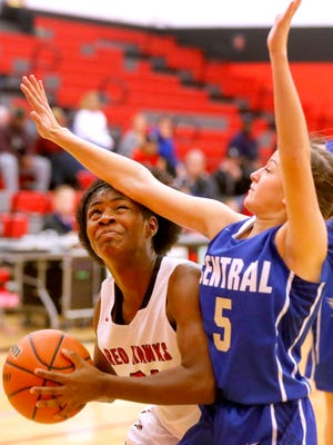 Stewarts Creek's Jamya Rogers (21) goes up for a shot as Wilson Central's Bailey Kaposy (5) defends her on Tuesday, Nov. 28, 2017, at Stewarts Creek.