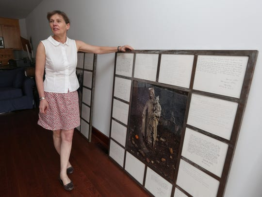 Artist Melinda Hunt at her Peekskill studio July 9, 2015. She has chronicled NYC's potter's field cemetery, Hart Island, in the Long Island Sound near City Island. This panel includes a photograph from the island and letters written by Riker's Island inmates tasked with burying New York's anonymous or indigent dead.