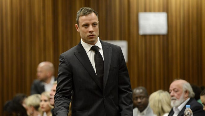 Oscar Pistorius arrives at the High Court in Pretoria on Oct. 21, 2014.