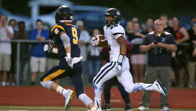 Marquis Carter (20) and Victor's Andrew Russell (9), during the Pittsford running back's  58-yard touchdown run in Week 3.