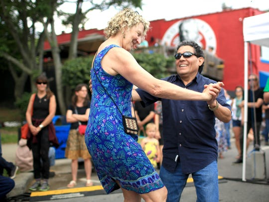 Anne Tansey and Rudy Rodriguez dance to the band Bayou Diesel, performing at the first Downtown After 5 of 2015 in Asheville.