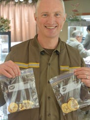 Dwight Patton, a UPS driver, holds cookies given to