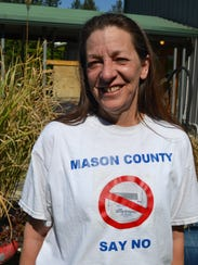 Colleen Walls of Belfair wears a shirt protesting Mason