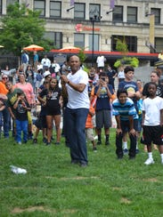 Mariano Rivera prepares to throw a pitch during his foundation's backpack giveaway in Wilmington last year.