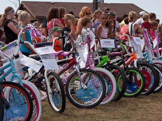 FILE - A file photo of the Two Rivers Optimist Club's Great Bike Giveaway.