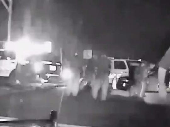 Screen shot of the dashcam video obtained by The Record of police at scene where attetmped car theft suspect Kashad Ashford was fatally shot by police in Rutherford on Sept. 16, 2014.