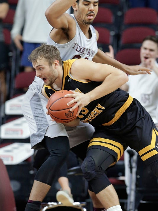 Northern Kentucky forward Carson Williams (23) drives around Texas A&M center Tyler Davis (34) during the first half of an NCAA college basketball game Tuesday, Dec. 19, 2017, in College Station, Texas. (AP Photo/Michael Wyke)