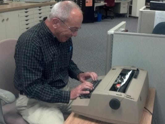 """Here's Rick Lee using what he calls a """"typewriter."""" Reporters can't always be Digital First."""
