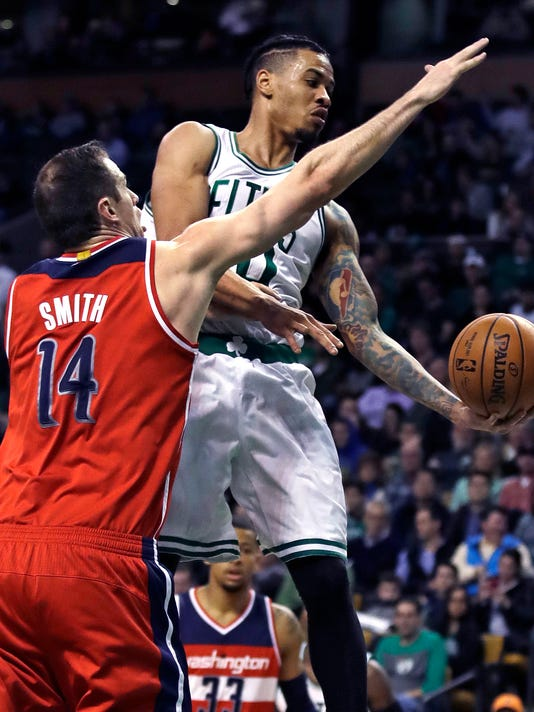 Washington Wizards forward Jason Smith (14) reaches for the ball on a drive to the basket by Boston Celtics forward Gerald Green (30) during the first quarter of an NBA basketball game in Boston, Wednesday, Jan. 11, 2017. (AP Photo/Charles Krupa)