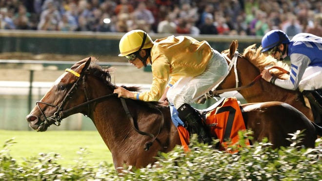 Departing pulls ahead en route to victory in Saturday night's Firecracker Stakes at Churchill Downs.