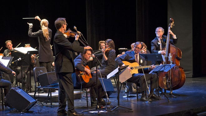 Left to Right: Paul Patterson on violin, George Cunningham and Brian Lovely on guitars and Don Aren on bass, with Karina Canellakis conducting the Cincinnati Chamber Orchestra