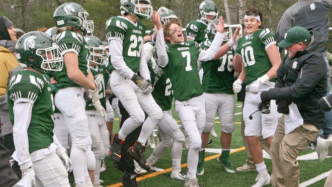 Oakmont Regional senior Keegan McMahon (7), shown celebrating with teammates and head football coach Nick McNamara after the Spartans' Thanksgiving win over Lunenburg, will attend Clark University in the fall and will play lacrosse for the Cougars.