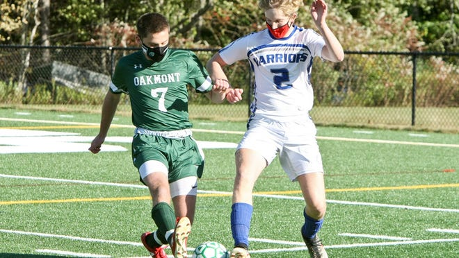 Oakmont's Cole Swanson (7) and Narragansett's Owen Lottig (2) vie for possession of the ball during Thursday afternoon's game at Arthur I. Hurd Memorial Field. Swanson tallied two goals in the Spartans' 3-0 win.