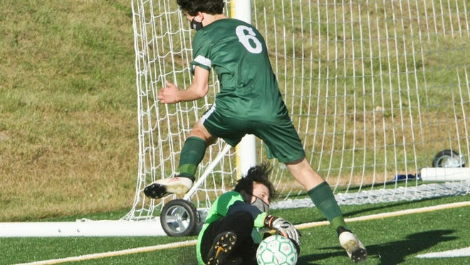 Narragansett goalkeeper Phoenix Drowne makes a save against Oakmont's Gianni Colautti (6) during Thursday afternoon's game at Arthur I. Hurd Memorial Field. The Spartans won 3-0.